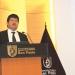 Ingeniero Luis Alberto Masías Changa brindando la conferencia  sobre las tendencias del comercio exterior peruano.